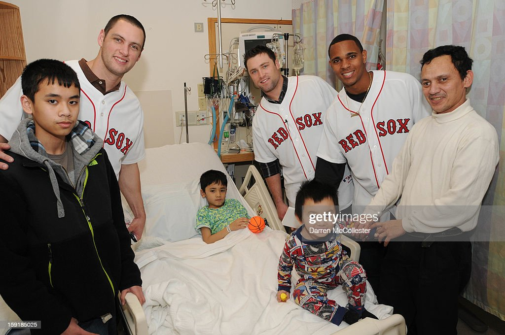Boston Red Sox rookies Alex Hassan, Bryce Brentz, and Xander Bogaerts spread cheer to Phillip (C), Dad, and brothers Peter (L) and Tim at Boston Children's Hospital on January 9, 2013 in Boston, Massachusetts.