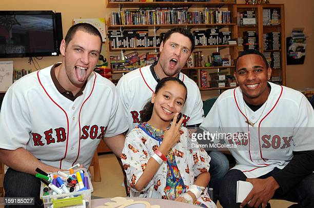 Boston Red Sox rookies Alex Hassan Bryce Brentz and Xander Bogaerts spread cheer to Ana at Boston Children's Hospital on January 9 2013 in Boston...