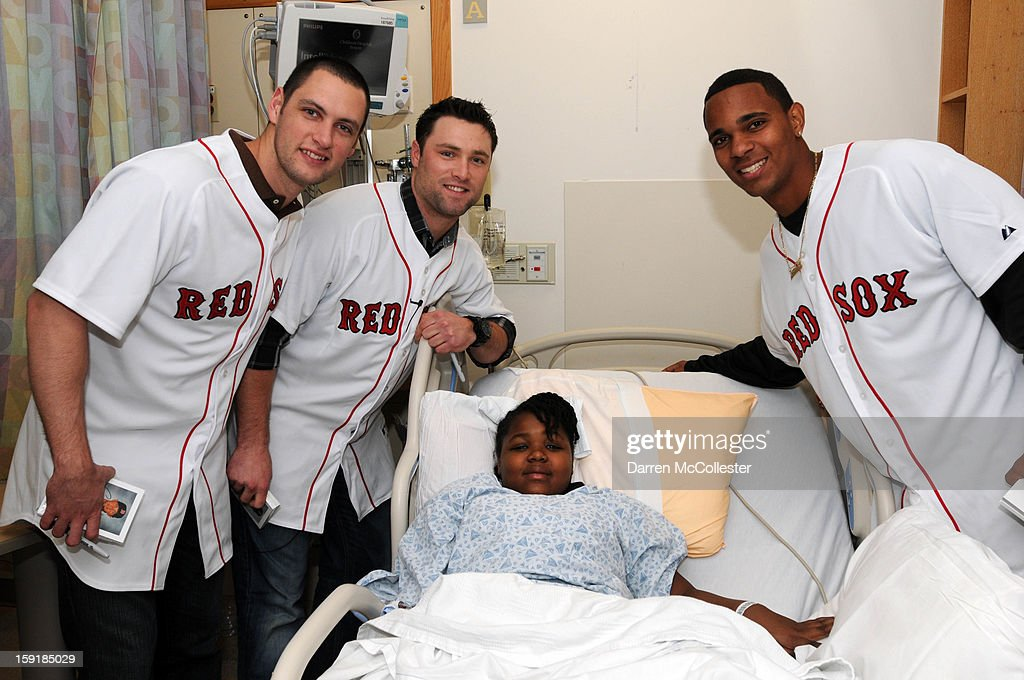 Boston Red Sox rookies Alex Hassan, Bryce Brentz, and Xander Bogaerts spread cheer to Jessica at Boston Children's Hospital on January 9, 2013 in Boston, Massachusetts.