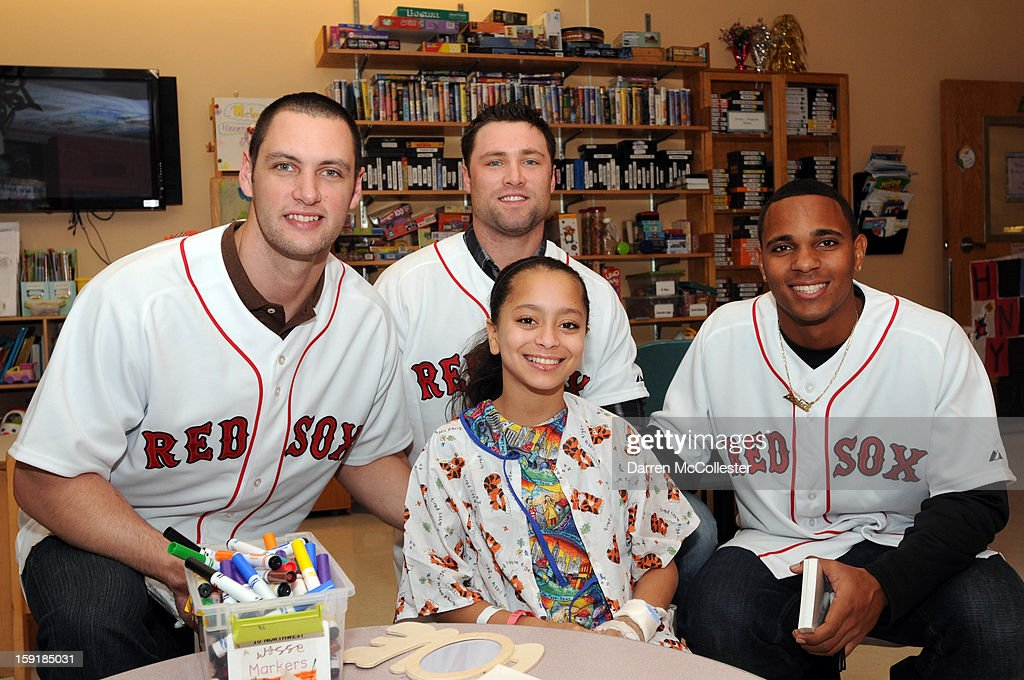 Boston Red Sox rookies Alex Hassan, Bryce Brentz, and Xander Bogaerts spread cheer to Ana at Boston Children's Hospital on January 9, 2013 in Boston, Massachusetts.