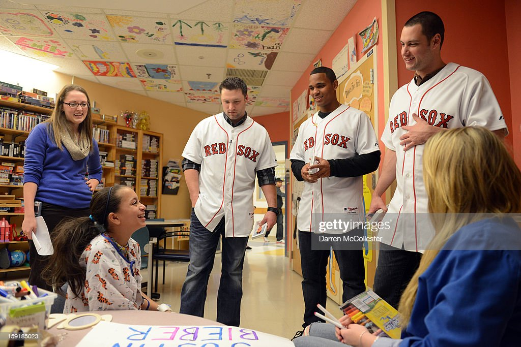 Boston Red Sox Rookies Bryce Brentz, Xander Bogaerts and Alex Hassan spread cheer to Ana at Boston Children's Hospital on January 9, 2013 in Boston, Massachusetts.