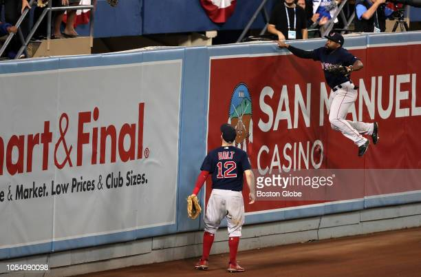 Boston Red Sox second baseman Brock Holt and Boston Red Sox center fielder Jackie Bradley Jr can only watch as the game winning home run by Los...