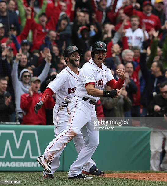 Boston Red Sox second baseman Dustin Pedroia and Boston Red Sox center fielder Jacoby Ellsbury celebrate after Ellsbury scored the game winning run...