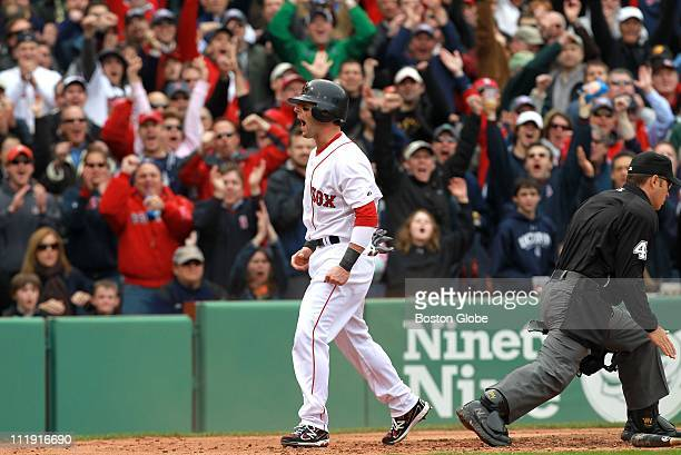 Boston Red Sox second baseman Dustin Pedroia lets out a howl after sliding home safely in a 5 run 2nd inning Boston Red Sox take on the New York...