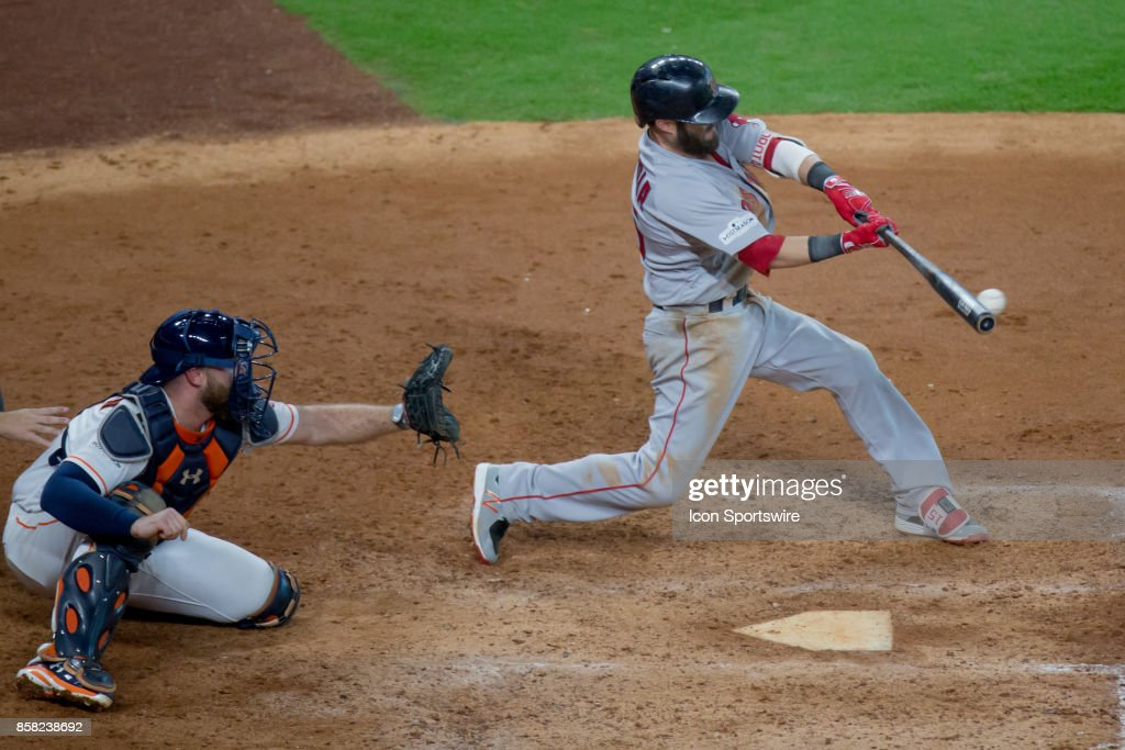 Boston Red Sox second baseman Dustin Pedroia (15) makes contact in the sixth inning during game one of American Division League Series between the Houston Astros and the Boston Red Sox at Minute Maid Park, Thursday, October 5, 2017. Houston Astros defeated Boston Red Sox 8-2.