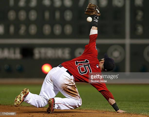Boston Red Sox second baseman Dustin Pedroia makes the stop and play from his knees for the out on a hard grounder by New York Yankees first baseman...