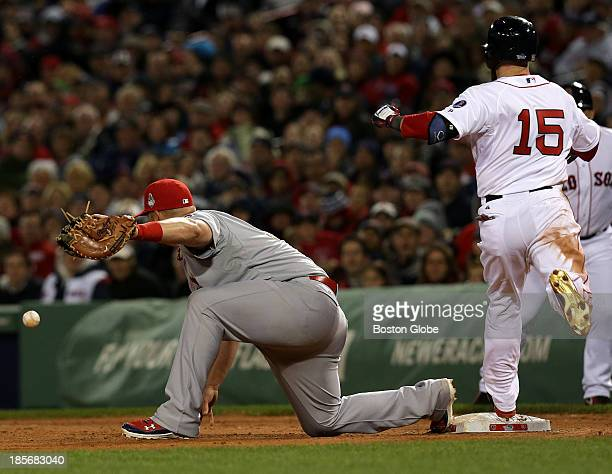 Boston Red Sox second baseman Dustin Pedroia reaches first base after the throw to first gets by St. Louis Cardinals first baseman Matt Adams in the...