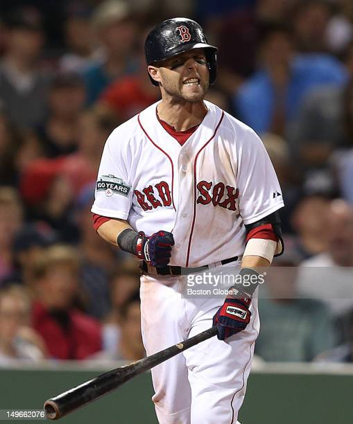 Boston Red Sox second baseman Dustin Pedroia reacts after striking out in the seventh inning as the Boston Red Sox took on the Detroit Tigers at...