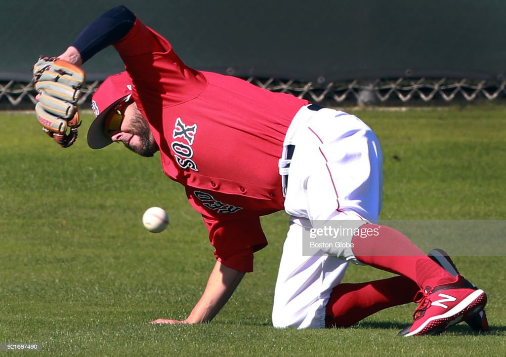 Boston Red Sox second baseman Dustin Pedroia, rehabbing from major restoration cartilage surgery on his left knee, attempts to field a ground ball during spring training at the Player Development Complex at Jet Blue Park in Fort Myers, FL on Feb. 20, 2018.