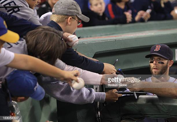 Boston Red Sox second baseman Dustin Pedroia signs autographs before the start of today's game The All Fenway Park team was honored in a pregame...