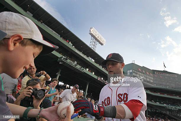 Boston Red Sox second baseman Dustin Pedroia signs autographs for fans before the game Pedroia is returning to the lineup after a stint on the DL...