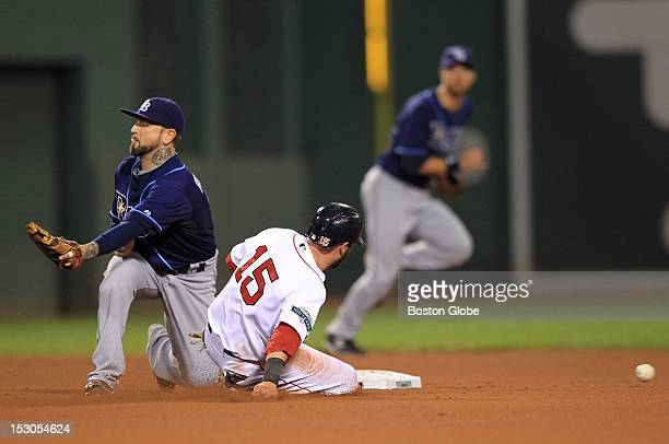 Boston Red Sox second baseman Dustin Pedroia steals his 100th base in the sixth inning as the Boston Red Sox take on the Tampa Bay Rays at Fenway...