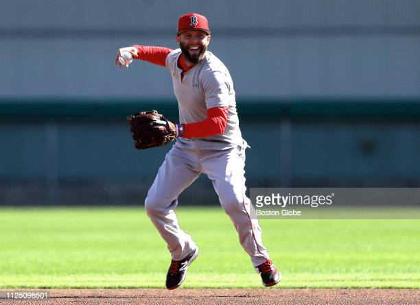 Boston Red Sox second baseman Dustin Pedroia takes part in an informal workout for position players during spring training at JetBlue Park in Fort...