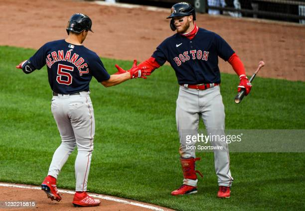 Boston Red Sox second baseman Enrique Hernandez is congratulated by center fielder Alex Verdugo after his solo home run during the Boston Red Sox...