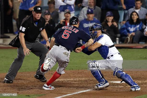 Boston Red Sox second baseman Ian Kinsler is tagged out trying to score the go ahead run during the tenth inning The Los Angeles Dodgers host the...