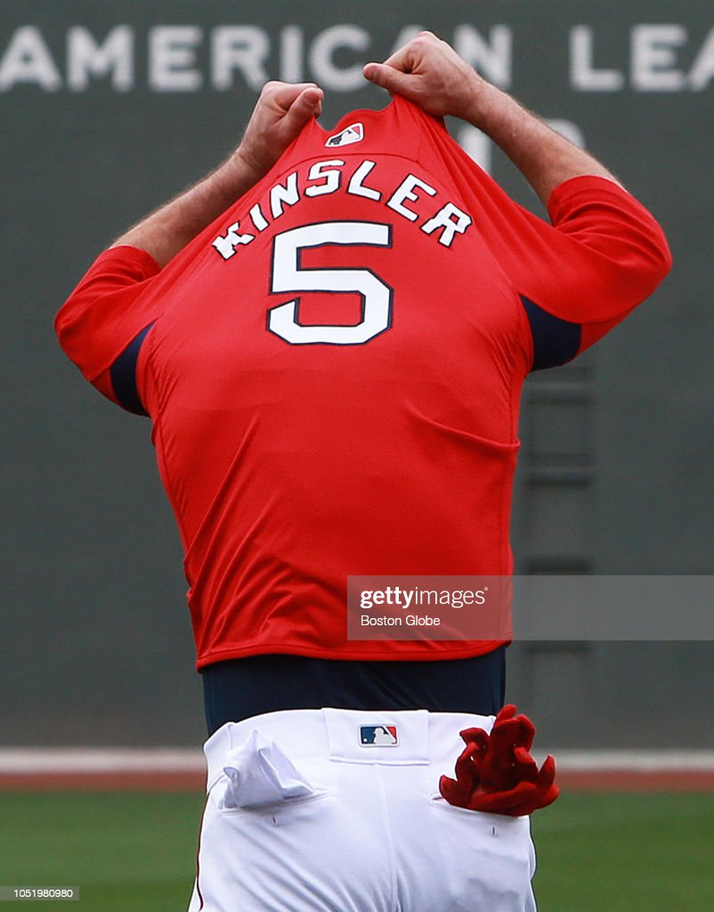 Boston Red Sox second baseman Ian Kinsler removes his shirt in ... afbcea530d8