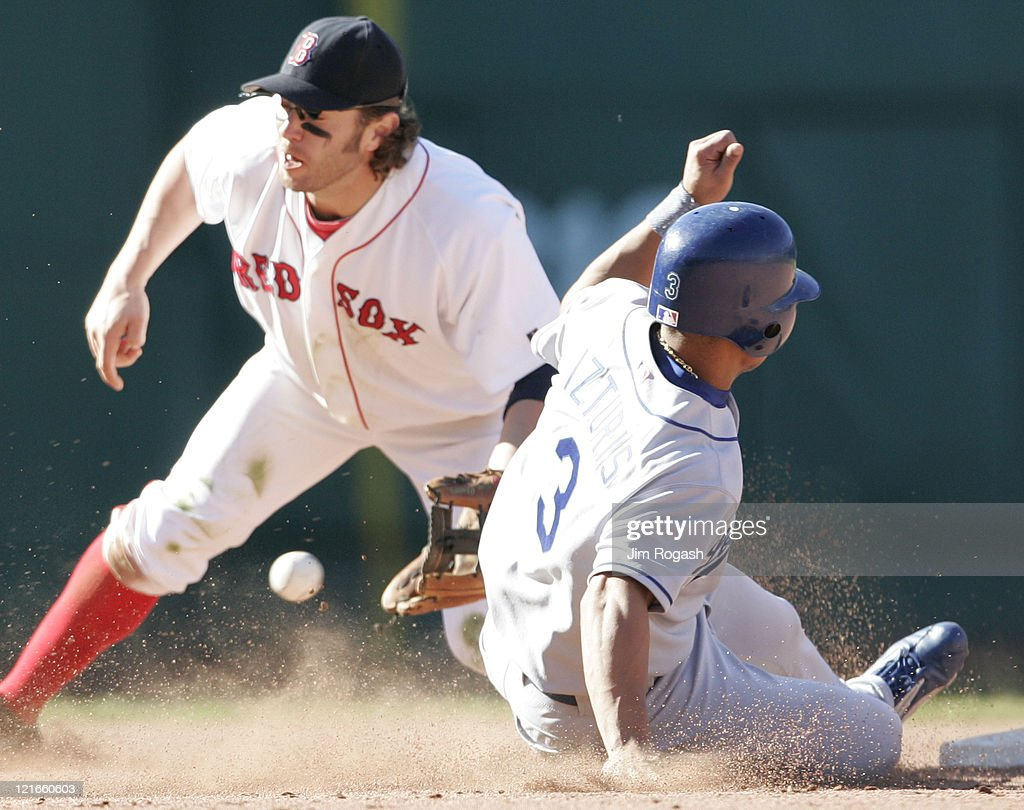 Boston Red Sox second baseman Mark Bellhorn, left, cannot handle the throw to second as Los Angeles Dodgers' base runner Cesar Izturis slides safely at Fenway Park in Boston, Massachusetts on June 12, 2004.