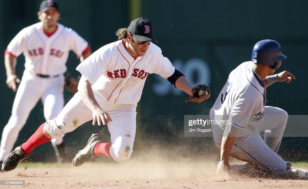 Boston Red Sox second baseman Mark Bellhorn, left, slaps a late tag on Los Angeles Dodgers' base runner Cesar Izturis as he slides safely at Fenway Park in Boston, Massachusetts on June 12, 2004.