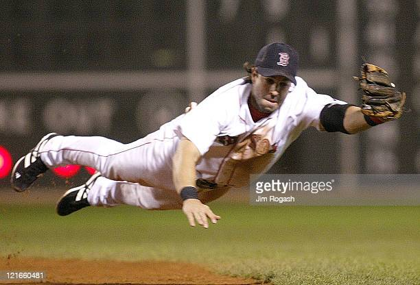Boston Red Sox second baseman Todd Walker dives for a line drive against the Baltimore Orioles tio no avail in the second inning at Fenway Park in...