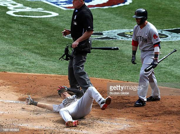 Boston Red Sox shortstop Jose Iglesias slides and rolls as he scores during a four run second inning The Boston Red Sox play the New York Yankees at...