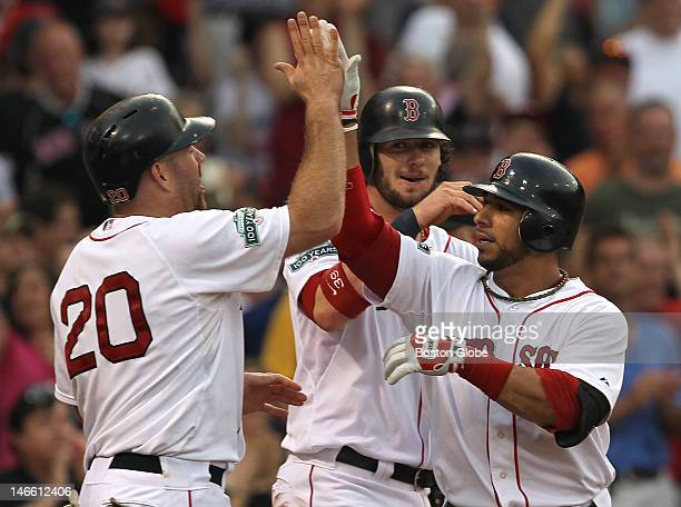 Boston Red Sox shortstop Mike Aviles is congratulated at the plate after his three run home run in the second inning as the Boston Red Sox took on...