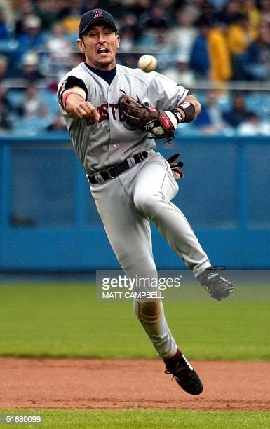 Boston Red Sox shortstop Nomar Garciaparra makes a leaping throw to get New York Yankees batter Rondell White in the sixth inning at Yankee Stadium...