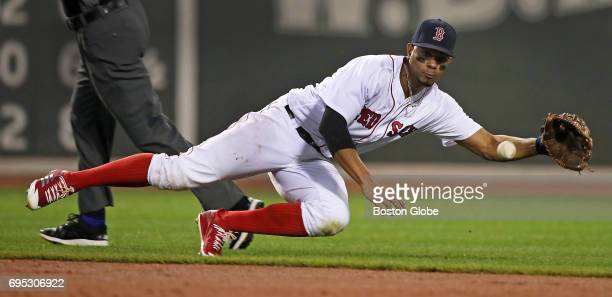 Boston Red Sox shortstop Xander Bogaerts makes a sliding catch of a ball hit by the Tigers' Victor Martinez Bogaerts made the grab then threw...