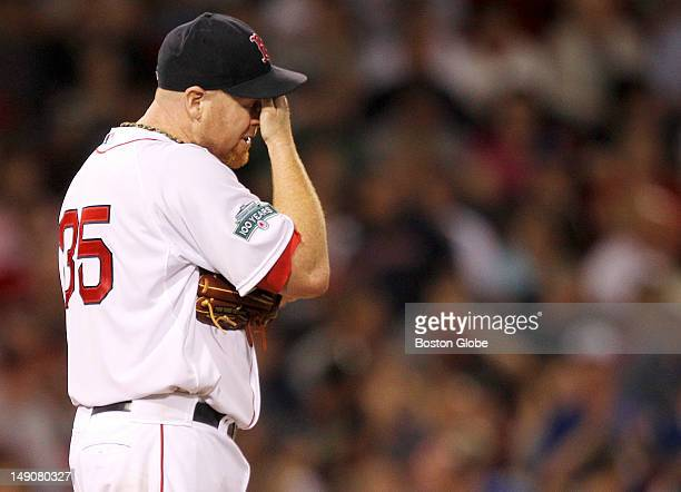 Boston Red Sox starting pitcher Aaron Cook reacts after giving up a game tying two run home run in the sixth inning. The Boston Red Sox took on the...
