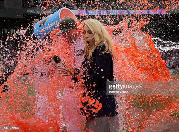 Boston Red Sox starting pitcher Brian Johnson and Guerin Austin side line reporter for NESN get doused with a double bucket shower following...