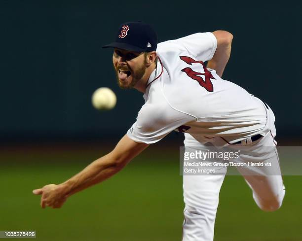 Boston Red Sox starting pitcher Chris Sale throws against the Toronto Blue Jays during the first inning of a Major League Baseball game at Fenway...