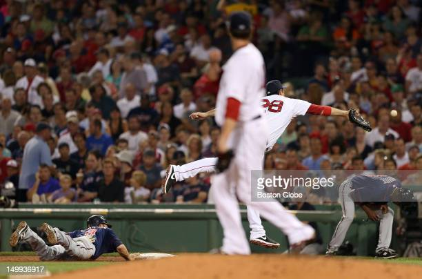 Boston Red Sox starting pitcher Clay Buchholz pick off throw to first base went astray for the second time in the game The Boston Red Sox took on the...