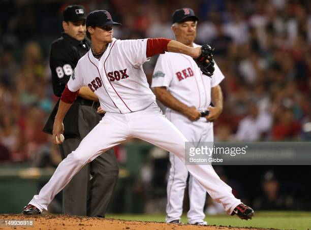 Boston Red Sox starting pitcher Clay Buchholz takes some trows off the mound in front of Boston Red Sox manager Bobby Valentine after appearing to...
