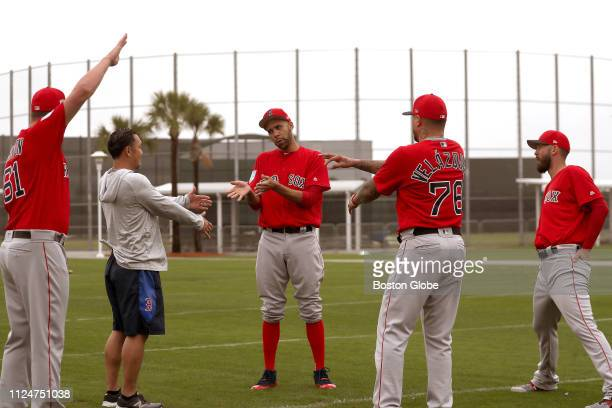 Boston Red Sox starting pitcher David Price and Red Sox pitchers stretch during the first spring training workout of the year for Boston Red Sox...