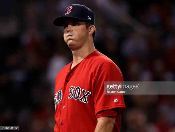 Boston Red Sox starting pitcher Drew Pomeranz heads to the dugout after getting the last out in the top of the fifth inning after giving up a two run...