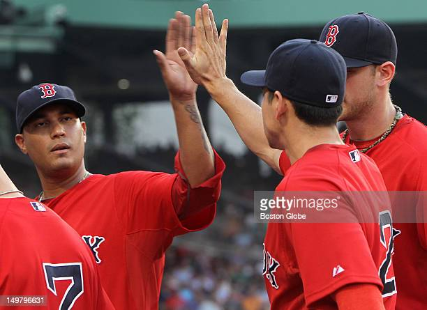 Boston Red Sox starting pitcher Felix Doubront congratulates Boston Red Sox center fielder Jacoby Ellsbury for a fine defensive catch in the first...