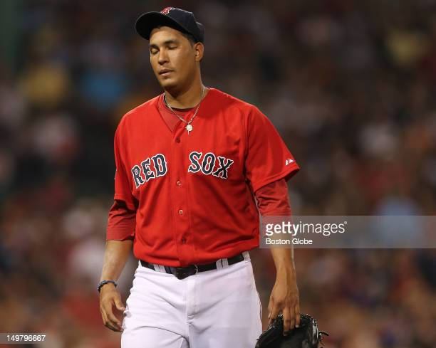 Boston Red Sox starting pitcher Felix Doubront heads to the Sox dugout at the end of the fifth inning as the Boston Red Sox took on the Minnesota...