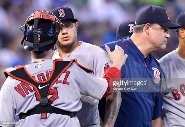 Boston Red Sox starting pitcher Hector Velazquez is relieved by manager John Farrell in the sixth inning against the Kansas City Royals on Monday...