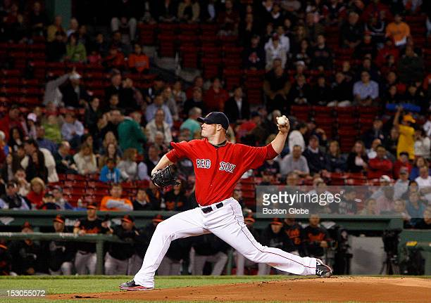Boston Red Sox starting pitcher Jon Lester pitches during the first inning with many empty seats in background as the Boston Red Sox took on the...