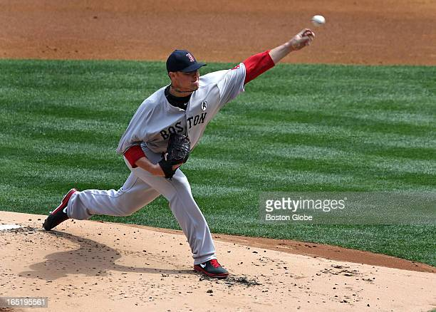 Boston Red Sox starting pitcher Jon Lester pitching against the New York Yankees The Boston Red Sox play the New York Yankees at Yankee Stadium...