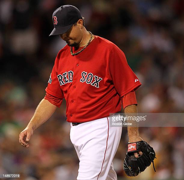 Boston Red Sox starting pitcher Josh Beckett heads to the dugout after the sixth inning as the Boston Red Sox took on the Toronto Blue Jays at Fenway...