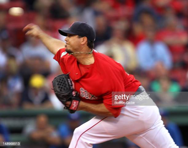 Boston Red Sox starting pitcher Josh Beckett pitches against the Toronto Blue Jays at Fenway Park.