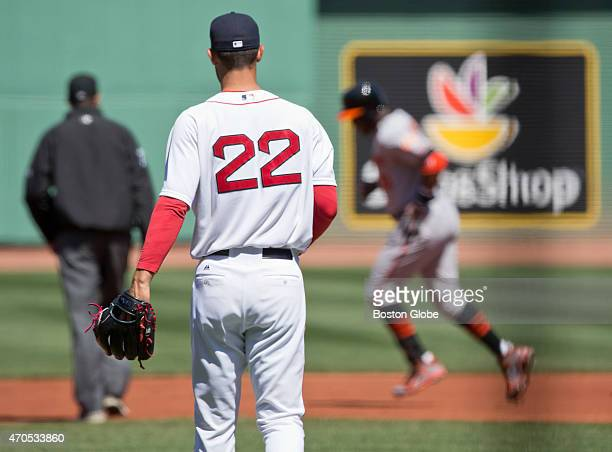 Boston Red Sox starting pitcher Rick Porcello watches as Baltimore Orioles Adam Jones hits a two run home run during first inning action at Fenway...