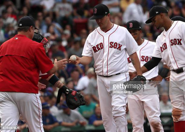 Boston Red Sox starting pitcher Steven Wright prepares to hand off the ball during a pitching change in the seventh inning The Boston Red Sox host...