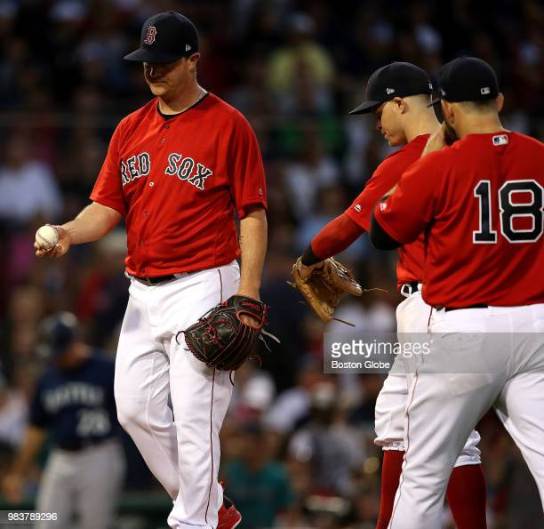 Boston Red Sox starting pitcher Steven Wright prepares to hand over the ball during the fourth inning The Boston Red Sox host the Seattle Mariners in...