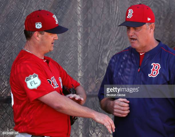 Boston Red Sox starting pitcher Steven Wright talks with Boston Red Sox manager John Farrell after a session of throwing off the mound on day eight...