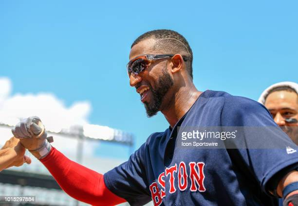 Boston Red Sox third baseman Eduardo Nunez is congratulated in the dugout after his fifth inning two run home run during the game between the Boston...