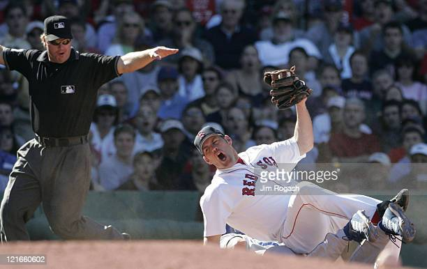 Boston Red Sox third baseman Kevin Youkilis reacts to q call by third base umpire Brian Runge in favor of Los Angeles Dodgers' Shawn Green at Fenway...
