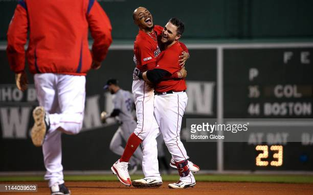 Boston Red Sox third baseman Michael Chavis is congratulated by teammate Mookie Betts after his gamewinning walkoff hit in the tenth inning The...