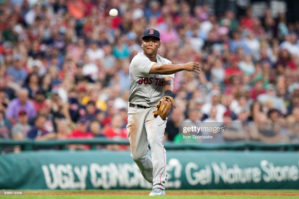 Boston Red Sox third baseman Rafael Devers (11) throws to first base for an out after making a diving stop during the third inning of the Major League Baseball game between the Boston Red Sox and Cleveland Indians on August 21, 2017, at Progressive Field in Cleveland, OH.