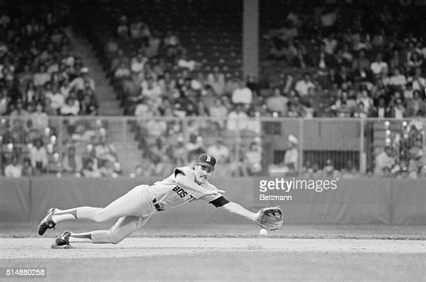 Boston Red Sox third baseman Wade Boggs dives for a groundball in a game against the Detroit Tigers.